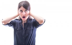 Woman-covering-her-ears-from-loud-noise